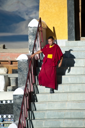 THIKSEY, INDIA - SEPTEMBER 13: Buddhist monk from Thiksey monastery in front of sentral temple entrance after morning puja ceremony on September 13, 2012 in Thiksey Gompa, Leh, Ladakh, india
