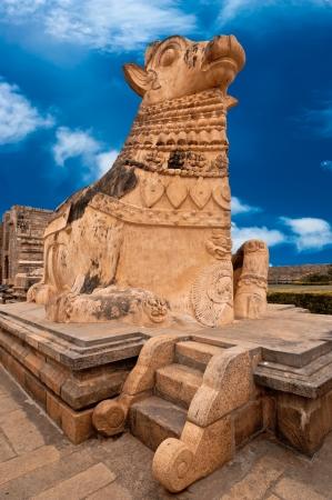 nandi: Big statue of Nandi Bull in front of Hindu Gangaikonda Cholapuram Temple. In Hinduism Nandi is a Shiva vehicle. South Indian architecture. India, Tamil Nadu, Thanjavur (Trichy)  Stock Photo: