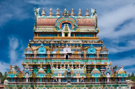 Great South Indian architecture. Sri Ranganathaswamy Temple. over blue sky. South India, Tamil Nadu, Thanjavur (Trichy) Фото со стока