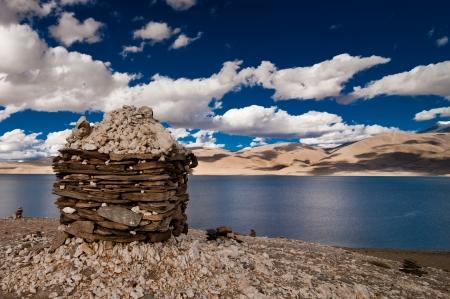 himalaya: Sunset at Tso Moriri Lake with Buddhist stupa ( chorten ) made from stones by nomad Tibetan people. Himalaya mountains landscape. India, Ladakh, altitude 4600 m