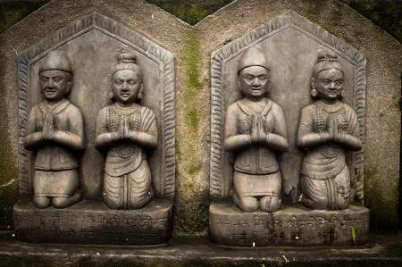 kathmandu: Sculpture of praying peoples. Architecture details at Buddhist shrine Swayambhunath Stupa. Monkey Temple Nepal, Kathmandu