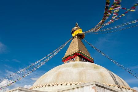kathmandu: Buddhist Shrine Boudhanath Stupa with pray flags over blue sky. Nepal, Kathmandu Stock Photo