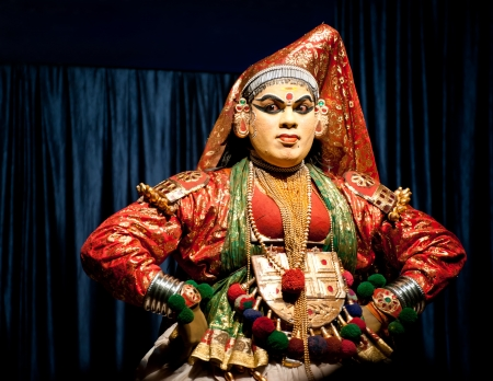 kathakali: THEKKADY , INDIA - FEBRUARY 19 : Indian actor performing traditional dance drama Kathakali on February 19, 2013 at Mudra Center. Actor performs Subhadra (minukku) character of Ramayana. India, Kerala