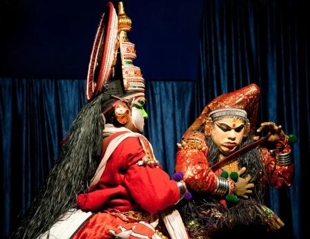 kathakali: THEKKADY , INDIA - FEBRUARY 19   Indian actor performing traditional dance drama Kathakali on February 19, 2013  Actor performs Arjuna and Subhadra characters of Ramayana  India, Kerala, Mudra Center
