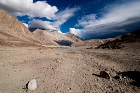 Himalaya high mountain landscape. Desert under dramatic cloudy sky.  India, Ladakh, altitude 4600 m