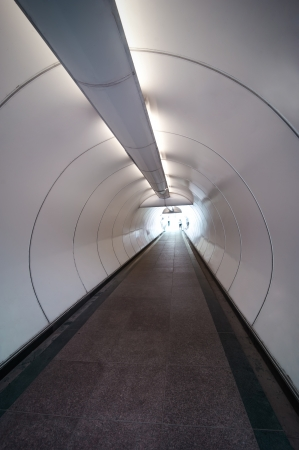 Modern pedestrian tunnel with people silhouettes photo