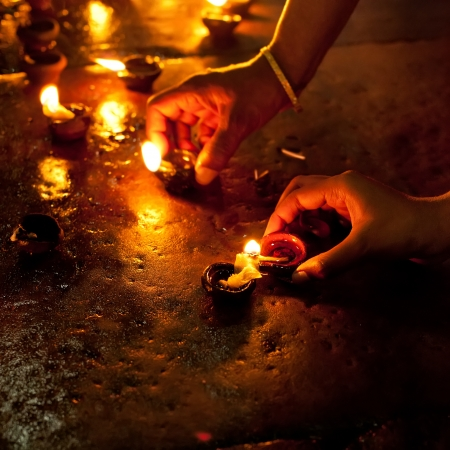 indian god: People burning oil lamps as religious ritual in Hindu temple. India