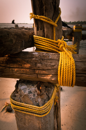 chinese fishing nets: Coarse coconut rope holds the wooden blocks at chinese fishing nets at Cochin (Kochi). South India, Kerala, Kochin