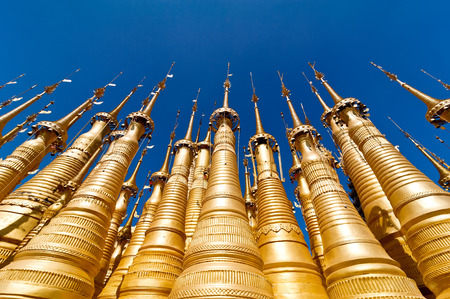 inle: Golden stupas of Shwe Indein Pagoda over blue sky. Indein village, Inle Lake, Shan State, Myanmar (Burma)