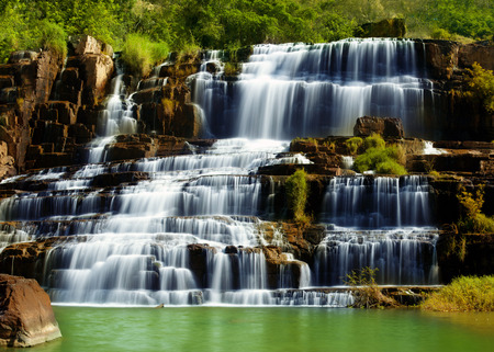 Tropical rainforest landscape with flowing Pongour waterfall in Vietnam. Four images panorama photo