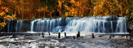 Tropical rainforest landscape with flowing Kulen waterfall in Cambodia. Two images panorama
