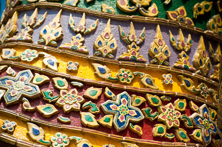 Traditional Thai style pattern at Wat Phra Kaeo, Temple of Emerald Buddha in Grand Royal Palace. Most important Buddhist temple in Bangkok, Thailand photo