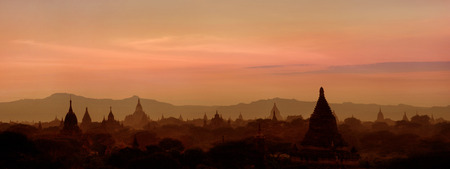 amasing: Amasing sunset over ancient architecture of old Buddhist Temples at Bagan Kingdom, Myanmar  Burma   Two images panorama Stock Photo