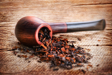 Grunge wooden texture with smoking pipe and tobacco on linen canvas Stock Photo