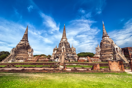 architecture ancient: Asian religious architecture. Ancient pagoda at Wat Phra Sri Sanphet temple under blue sky. Ayutthaya, Thailand