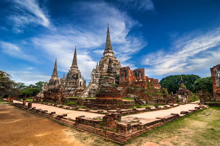 ayutthaya: Asian religious architecture. Ancient pagoda at Wat Phra Sri Sanphet temple under blue sky. Ayutthaya, Thailand
