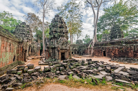 angkor wat: Ancient Khmer architecture. Panorama view of Ta Prohm temple with giant banyan trees at Angkor Wat complex, Siem Reap, Cambodia Stock Photo