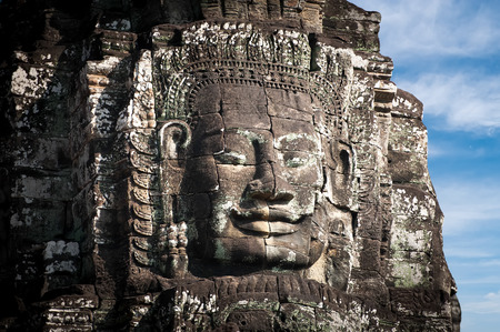 Ancient Khmer architecture. Huge carved Buddha faces of Bayon temple at Angkor Wat complex, Siem Reap, Cambodia photo