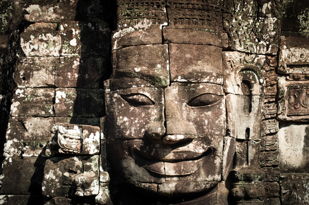 bayon: Ancient Khmer architecture. Huge carved Buddha faces of Bayon temple at Angkor Wat complex, Siem Reap, Cambodia