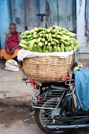 TRICHY, INDIA - FEBR 14: Indian men selling greengrocery at street market place on Febr 14, 2013. India, Tamil Nadu, Thanjavur (Trichy)