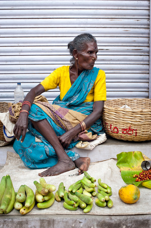 TRICHY, INDIA - FEBR 14: Indian women selling greengrocery at street market place on Febr 14, 2013. India, Tamil Nadu, Thanjavur (Trichy)