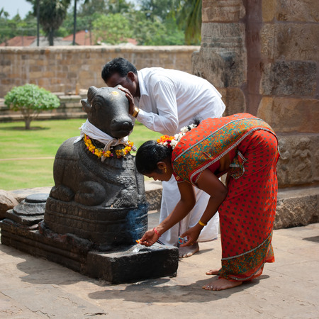 nandi: THANJAVUR, INDIA - FEBRUARY 13: Indian people brings offerings to Nandi Bull at Gangaikonda Cholapuram Temple on February 13, 2012. India, Tamil Nadu, Thanjavur (Trichy) Editorial