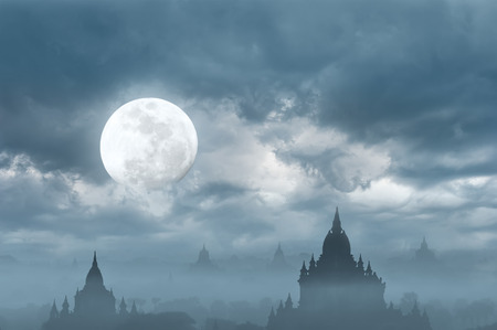 Amazing silhouette under moon at mysterious night  Fantasy   photo