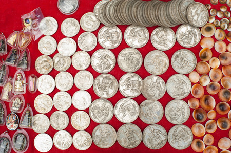 francaise: Old cheap souvenir coins for sale at asian market. Laos