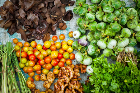 asian produce: Fresh organic vegetables, herbs and spices at asian market Stock Photo