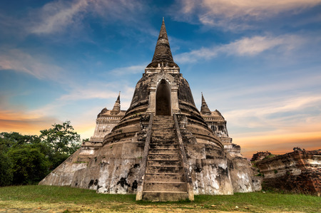 khmer: Asian religious architecture. Ancient Buddhist pagoda ruins at Wat Phra Sri Sanphet temple under sunset sky. Ayutthaya, Thailand travel landscape and destinations