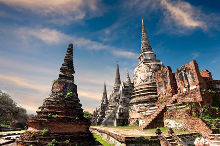 architecture ancient: Asian religious architecture. Ancient Buddhist pagoda ruins at Wat Phra Sri Sanphet temple under sunset sky. Ayutthaya, Thailand travel landscape and destinations