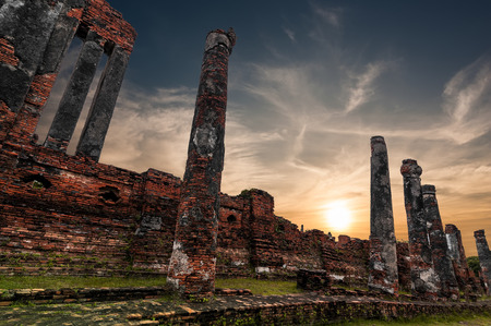 Asian religious architecture. Ancient Buddhist pagoda ruins at Wat Phra Sri Sanphet temple under sunset sky. Ayutthaya, Thailand travel landscape and destinations photo