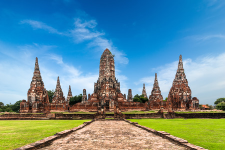 ayutthaya: Asian religious architecture. Amazing panorama view of ancient Chai Watthanaram temple ruins under blue sky. Ayutthaya, Thailand travel landscape and destinations