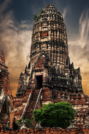 architecture ancient: Asian religious architecture. Ancient Buddhist pagoda ruins at Chai Watthanaram temple under sunset sky. Ayutthaya, Thailand travel landscape and destinations