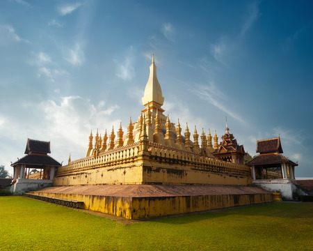 vientiane: Religious architecture and landmarks. Golden buddhist pagoda of Phra That Luang Temple under sunset sky. Vientiane, Laos travel landscape and destinations