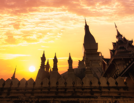 that: Religious architecture and landmarks. Golden buddhist pagoda of Phra That Luang Temple under sunset sky. Vientiane, Laos travel landscape and destinations