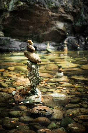 rock garden: Amazing tropical rain forest landscape with lake and balancing rocks tower for zen meditation practice. Nature background Stock Photo