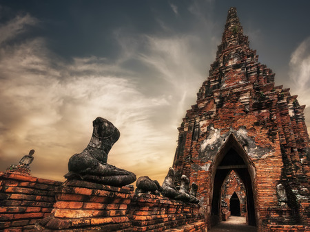 Asian religious architecture. Ancient Buddhist pagoda ruins\ at Chai Watthanaram temple under sunset sky. Ayutthaya, Thailand\ travel landscape and destinations