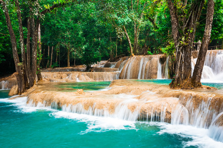 si: Jangle landscape with amazing turquoise water of Kuang Si cascade waterfall at deep tropical rain forest. Luang Prabang, Laos travel landscape and destinations