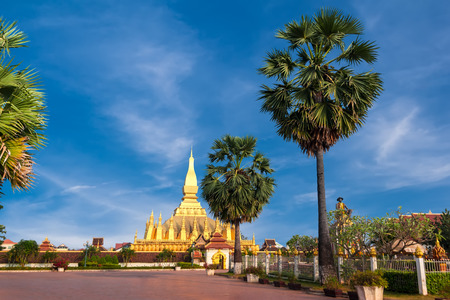 vientiane: Religious architecture and landmarks. Golden buddhist pagoda of Phra That Luang Temple under blue sky. Vientiane, Laos travel landscape and destinations