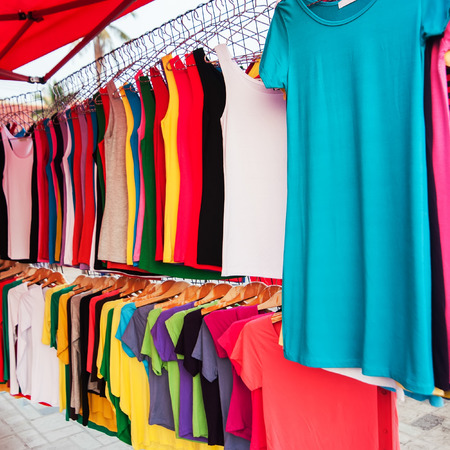 A lot of colorful shirts for sale at market photo