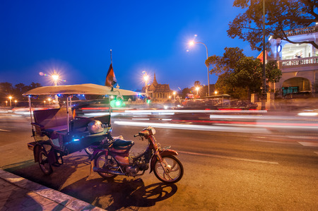 penh: Moto taxi at asian city. Scene of night life at most popular tourist street near Mekong river in capital city Phnom Penh, Cambodia