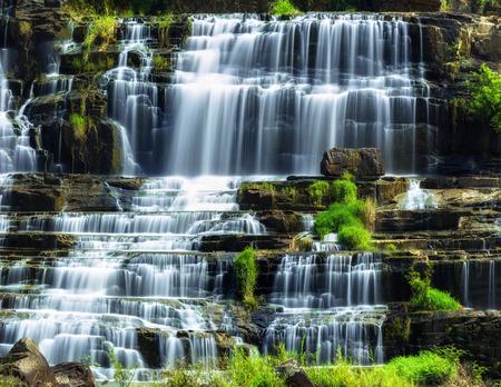 lat: Tropical rainforest landscape with flowing Pongour waterfall. Da Lat, Vietnam