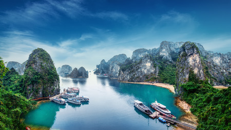 cave: Tourist junks floating among limestone rocks at Ha Long Bay, South China Sea, Vietnam, Southeast Asia