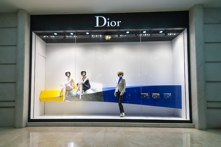haute couture: HO CHI MINH, VIETNAM - JAN 21, 2014: Christian Dior boutique display window with haute couture clothes and luxury accessories for exclusive shopping and in most attractive tourists city in Vietnam Editorial