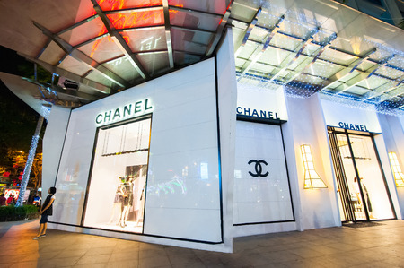 haute couture: HO CHI MINH, VIETNAM- JAN 21, 2014: Chanel boutique display window with mannequin in haute couture clothes and luxury accessories for exclusive shopping and in most attractive tourists city in Vietnam