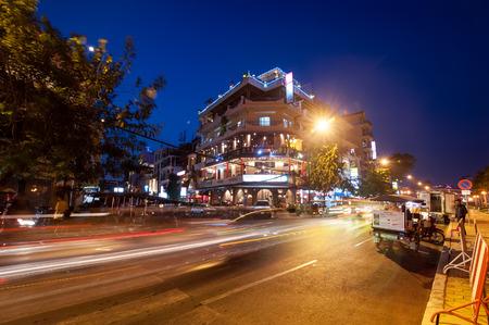 penh: PHNOM PENH, CAMBODIA - DEC 29, 2013: Scene of night life at most popular tourist street near Mekong river in capital city Phnom Penh, Cambodia Editorial