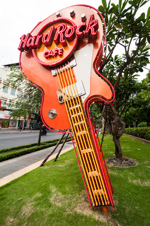 famous industries: HO CHI MINH, VIETNAM - JAN 21, 2014: Electric guitar famous symbol of Hard Rock Cafe in Ho Chi Minh City (Saigon). One of most visited restaurants
