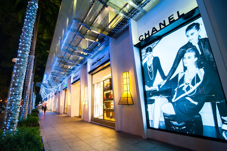 haute couture: HO CHI MINH, VIETNAM- JAN 21, 2014: Chanel boutique display window with haute couture clothes and luxury accessories advertising for exclusive shopping and in most attractive tourists city in Vietnam