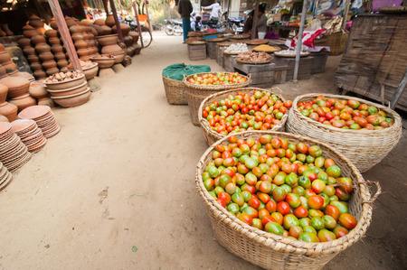 Ripe organic tomatoes for sale at outdoor asian marketplace. Bagan, Myanmar. Burma travel destinations photo